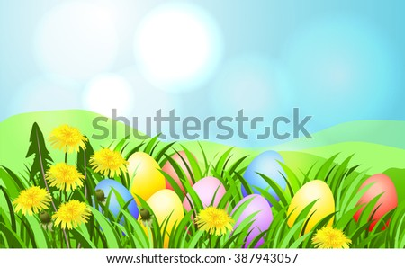 Easter sunbeam card with painted eggs in green grass.
