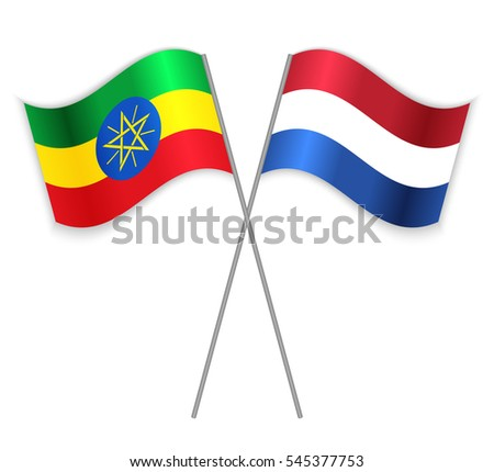 Ethiopian and Dutch crossed flags. Ethiopia combined with Netherlands isolated on white. Language learning, international business or travel concept.