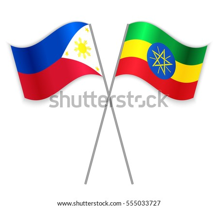 Filipino and Ethiopian crossed flags. Philippines combined with Ethiopia isolated on white. Language learning, international business or travel concept.
