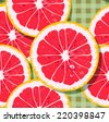 Fresh pattern with grapefruit slices on green background - stock vector