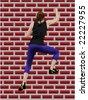 girl climbing wall - stock vector