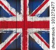 Grunged British Union Jack Flag over a wooden plank  background  illustration - stock photo