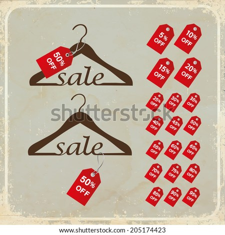 "Hangers with tags and word ""sale"" on grunge background"