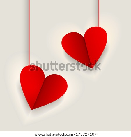 Hanging heart shape fold paper sticky in red color on abstract brown background for Valentines Day celebrations, can be use as tag or label.