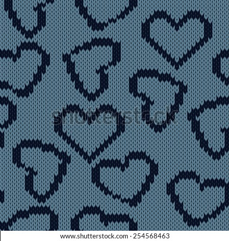 Knitted background with the image of hearts