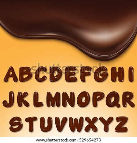 Latin alphabet made of dark melted chocolate .