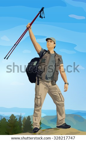 Man tourist with hiking poles in hand standing on mountain top