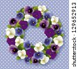 Pansy Wreath. Spring garden flowers in purple, lavender, blue and white. Viola hortensis. White polka dots on pastel blue background with copy space. EPS8 compatible. - stock vector