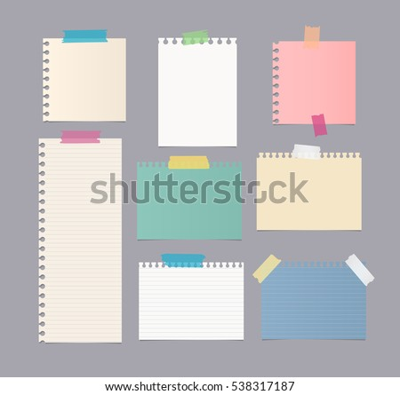 Pieces of different size colorful note, notebook, copybook paper sheets stuck with sticky tape on gray background