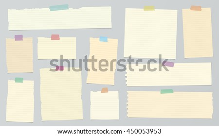 Pieces of light brown ruled torn note paper with colorful adhesive, sticky tape.