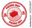 Red grunge rubber stamp with the text picnic day written inside, vector illustration - stock vector