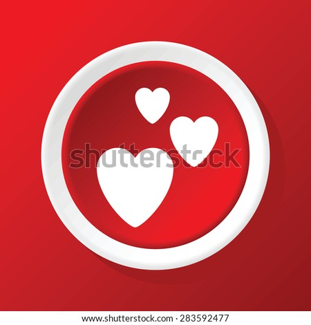 Round icon with image of three hearts, on red background