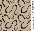 seamless pattern of horseshoe silhouettes on the beige background vector - stock vector