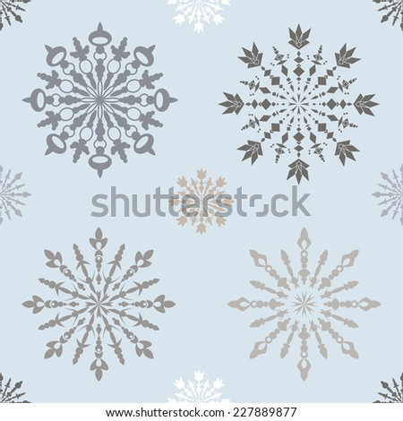 Seamless vintage pattern with large and small blue  snowflakes on light background