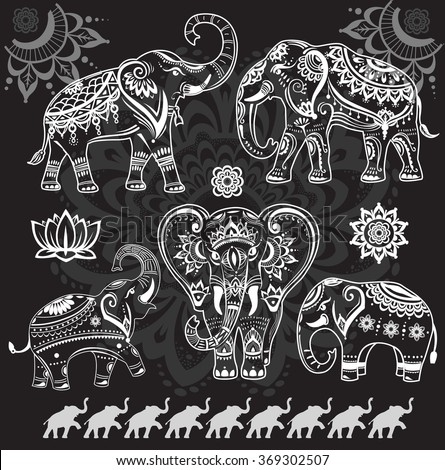 Set of decorated elephants on black