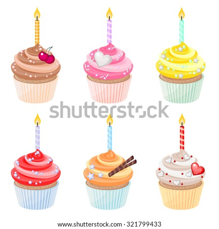 Set of festive birthday cupcakes with burning candles