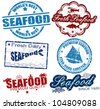 Set of grunge rubber stamps with the word seafood written inside, vector illustration - stock vector