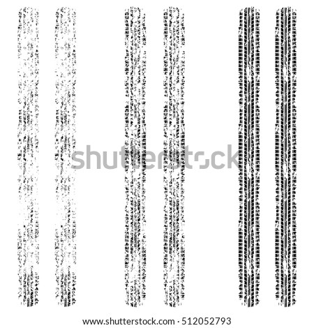 Set of three grunge tire tracks isolated on white background