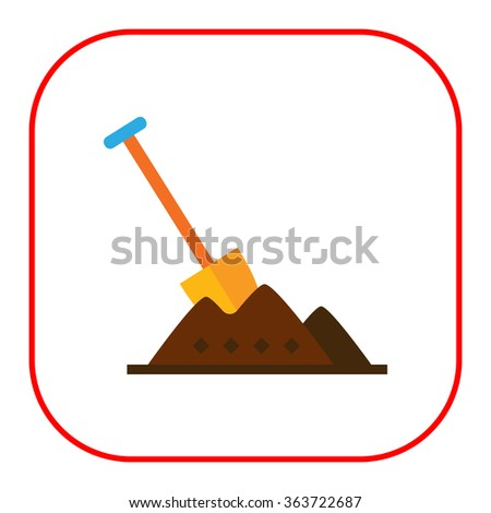 Shovel in heap of soil