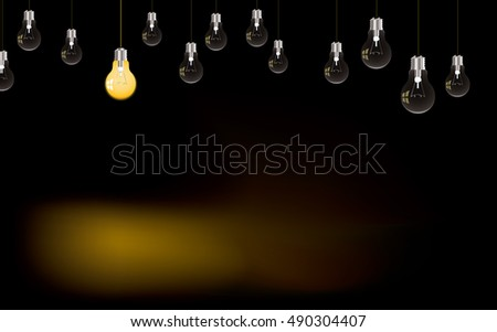 Single lone light bulb lit in darkness