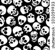Skulls in Black Background Seamless Pattern - stock vector