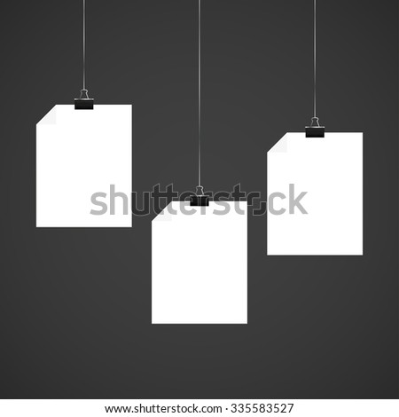 Three  white sheets of papers with letter clips on a black background