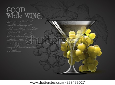 transparent glass of white wine and a branch of grapes