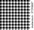 Trendy hounds tooth pattern that tiles seamlessly as a pattern. - stock photo