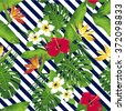 Tropical exotic flowers and leaves on the dark blue diagonal strips. Seamless pattern. Vector. - stock vector