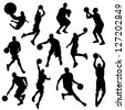 vector basketball players in silhouettes - stock vector