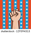 Vector Illustration of a raised fist front of American stars and stripes. - stock