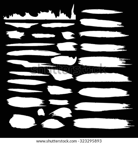 Vector ink stain Vector set of white   blots Isolated on  Black background Abstract vector background set for design use Collection of white  paint splash. Vector set of brush strokes. Ink Splat Set