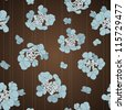 Vector seamless pattern with blue flowers on the brown background - stock vector