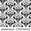 Vector seamless patterns consisting of abstract flowers, decorated in  	black-and-white color - stock vector