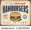 Vintage Metal Sign - Try Our Homestyle Hamburgers - Vector EPS10. Grunge effects can be easily removed for a brand new, clean design. - stock vector