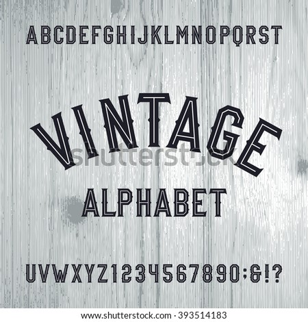 Vintage style alphabet font. Letters and numbers on the light wooden background. Retro vector typeface for labels, flyers, headlines, posters etc.