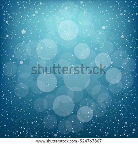 Winter blue bokeh background with snow. Christmas and New Year backdrop