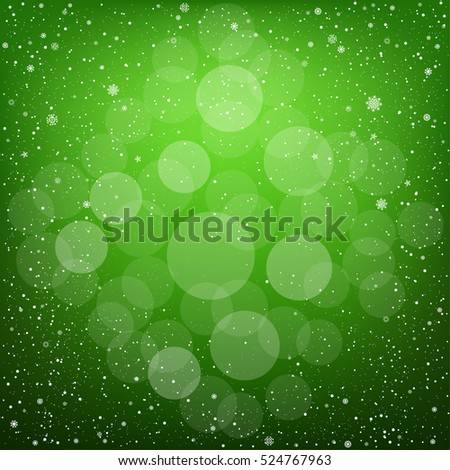 Winter green bokeh background with snow. Christmas and New Year backdrop