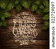 Wooden background with painted holiday typography and Christmas fir tree. Vector illustration - stock vector