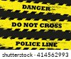 Yellow danger lines on dark background. Danger ribbon - stock photo
