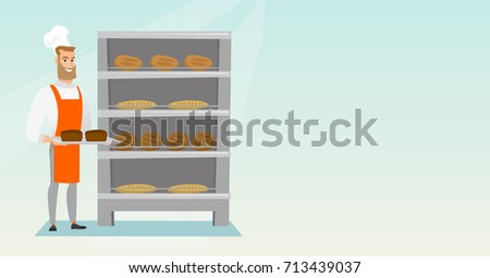 Young Caucasian Baker Holding A Tray With Bread In A Bakery Confident Male Baker Standing
